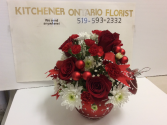 Red ornament table arrangement