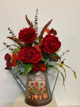 Red poppy in watering can (artificial)   Silk Arrangement