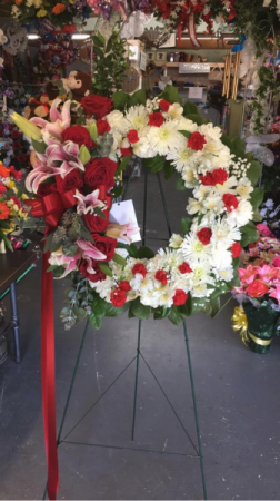 RED ROSE AND LILY STANDING WREATH STANDING SPRAYS & WREATHES