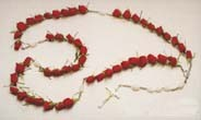 Red Rose Casket Rosary Standing Spray in Holbrook, MA | WHITE FLOWERS & GIFTS