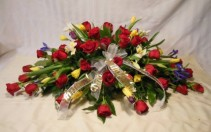 RED ROSES AND SPRING FLOWERS CASKET SPRAY