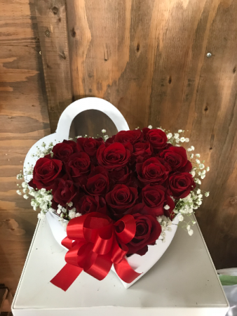 Red roses in a heart shape box