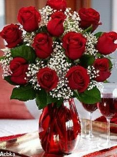 Red roses in red vase vase arrangement