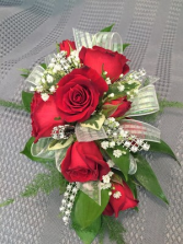 Red  sweetheart rose Corsage  Your choice of ribbon and gold or silver sparkles