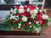 Red & White Traditions Casket Spray