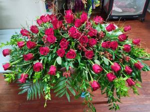 Regal Roses Casket Spray in Henderson, TX | RAYFORD FLORIST & GIFTS
