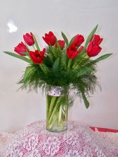 Romantic Red Tulips Ten tulip stems arranged in a vase with greens and fillers.