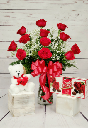 Rosebud Valentine's Day Special Dozen red roses arranged in a vase, teddy bear and a box of chocolates in Pawtucket, RI | ROSEBUD FLORIST INC.