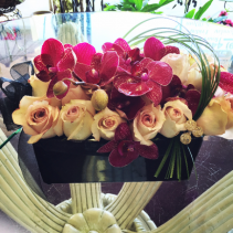 Roses and orchids in compact floral bouquet