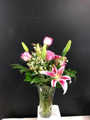 Roses and Stargazers  in Garner, NC | BLOOMIES ON 42 LLC.