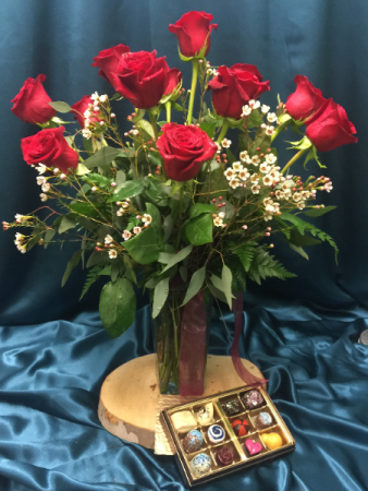 A dozen roses with a dozen Chocolates arranged and delivered in the Iowa City Area