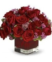 OC 4-Roses in a compact arrangement Flowers and colors may vary