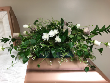 Roses on Vinca Minor Casket Arrangement