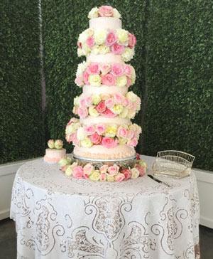 Rosey Waterfall Wedding Cake Flowers in Stonewall, MB | STONEWALL FLORIST