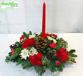 Round christmas centerpiece with candle
