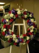 Round fresh flower wreath Funeral flowers