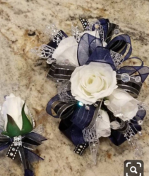 Royalty wrict corsage and boutonniere