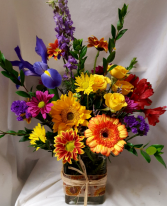 """Burst of Autumn Bouquet"" seasonal mixed bright fall flowers arranged in a rectangular vase with ribbbon detail!"