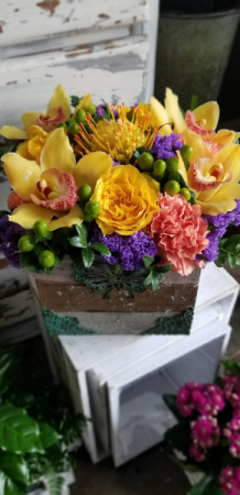 rustic box filled with orchids etc