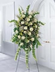SS 5- Standing spray of mixed flowers Flowers and colors may vary
