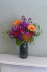 Sangria Protea, Gerbera,Roses & Alstromeriain Purple Mason Jar