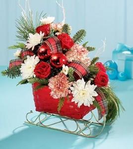 Santa's Sleigh  *custom floral arrangement in a sleigh in Lebanon, NH | LEBANON GARDEN OF EDEN FLORAL SHOP