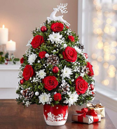 Santa's Sleigh Ride™ Holiday Flower Tree® Arrangement
