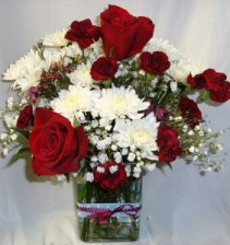 Maroon carnation included in this cute vase with a blue and white polka dot ribbon. Maroon and white flowers arranged!!