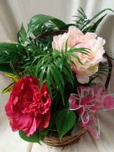 Planter with silk pink peonies and bow. Nice  keepsake for someone to take home after services.