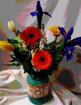 Mason Jar with lace filled with bright flowers. Vase color may vary.