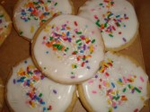 Dozen iced Sugar cookies with sprinkles! Order  need 30 hour notice for delivery