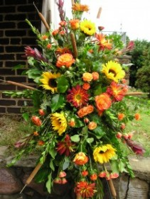 Seasonal fall standing spray Funeral flowers