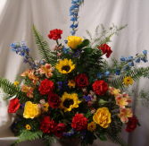 Seasonal funeral arrangement...if sunflowers are not available we will use large yellow gerbera daisies. We may substitute because of seasonal flowers but  will stick to the color scheme.