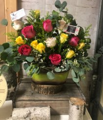 Seeded Eucalyptus with pink and yellow sympathy ba arrangement