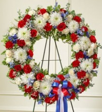 Serene Blessings Red, White & Blue Standing Wreath sympathy flowers