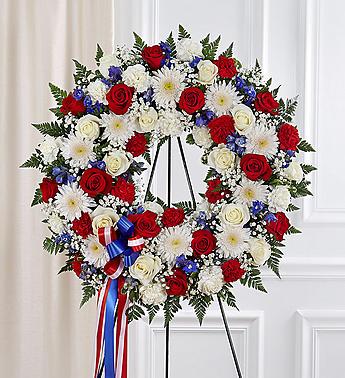 Serene Blessings™ Standing Wreath- Red, White & Bl funeral spray