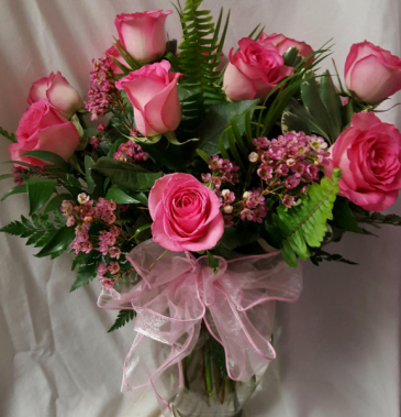 DOZEN PINK ROSES ARRANGED WITH WAX FLOWER OR BABY' BREATH...WHAT EVER IS IN STOCK AND SEASONAL