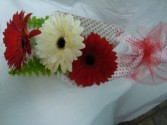 3 LARGE RED AND WHITE GERBERAS WRAPPED WITH GREENS TO BE DELIVERED!!