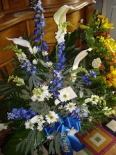 Shades of Blue Blue and Wht Funeral Spray