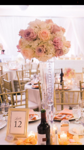 Shades of blush and cream colored wedding topper Wedding centerpieces