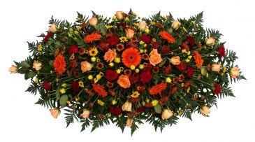 Shades of Orange memorial spray  casket spray arrangement.