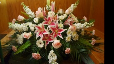 SWEET MEMORIES Half Casket Spray of pinks and whites. Stargazer Lillies, pink roses, snap dragons, carnations and more