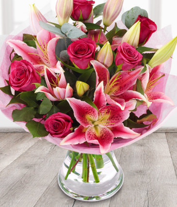 shades of pink wrapped bouquet with vase