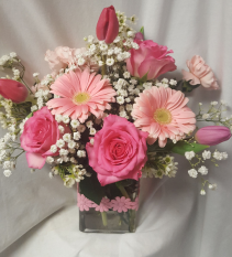 """Shades of Pinks""...rectangular vase filled with roses, gerbera daisies, carnations and flowers  that are in season."