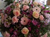 ETERNAL PEACE Half Casket Spray of pinks,purples and lavenders. Roses, Gerbera Daisies, daisies,carnations and more.