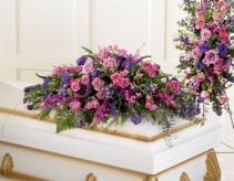 JOYFUL THOUGHTS Half Casket Spray of shades of Purples. Roses, iris, snapdragons, status and more