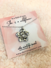 She is a wildflower necklace