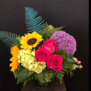 She's a carnival  Cylinder  in Chesterfield, MO | ZENGEL FLOWERS AND GIFTS