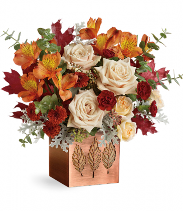 Shimmering Leaves(Container may vary) All-Around Floral Arrangement