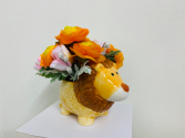Silk Arrangement in a ceramic lion Silk Arrangement